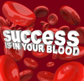 The words Success is in Your Blood surrounded by red cells